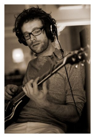 Nic Basque recording his melodic guitar playing.